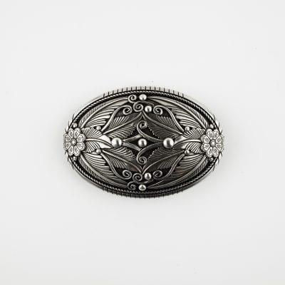A removable ornate belt buckle