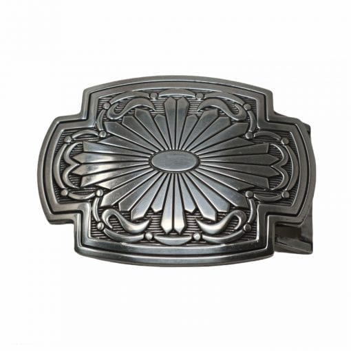 An ornate belt buckle for jeans